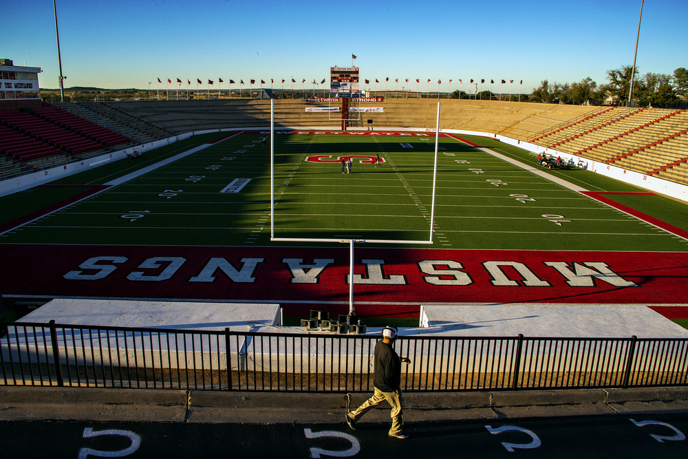 A member of the Lamesa Golden Tornadoes coaching staff walks down the ramp leading to the Mustang Bowl field in Sweetwater, Texas prior to the Golden Tornadoes' game against the Sweetwater Mustangs on Nov. 7, 2014. Built in 1939 by Civilian Conservation Corps members, the Mustang Bowl is one of the most unique stadiums in the state, featuring a field enclosed by an oval extension of the grandstand. It has been widely hailed as one of the top stadiums in Texas, meriting an inclusion to the Texas Football Stadium Hall of Fame.