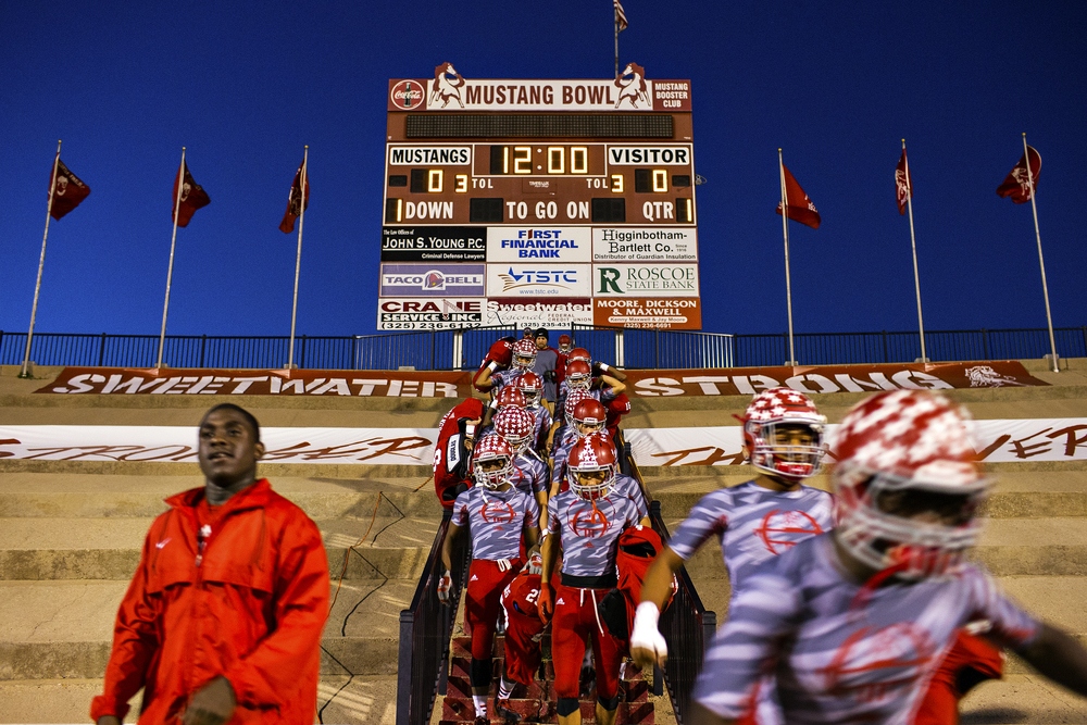 Sweetwater's offensive players walk down the Mustang Bowl staircase as they begin warming up for their senior night game against the Lamesa Golden Tornadoes Nov. 7, 2014 at the Mustang Bowl in Sweetwater, Texas. The Mustang Bowl sits in a city of a little over 11,000 people, with its home-team classified by the UIL among 4A (3A before 2014) schools. The Mustangs are one of the most successful 3A programs in the state, having amassed the fourth-most wins all-time in the classification, although they have only won one state championship, in 1984.