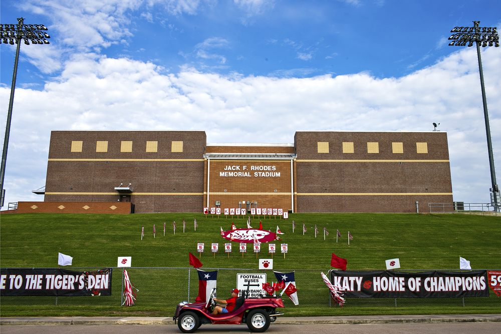 A Katy High School fan drives a Katy-themed convertible past Jack F. Rhodes Memorial Stadium prior to the Tigers' homecoming game against the Katy Taylor Mustangs on Sept. 26, 2014 in Katy, Texas. The Tigers would go on to play an almost flawless game and beat the Mustangs 50 - 7. Probably the most recognizable high school football team in the state, the Katy Tigers are used to blowout victories and state championship seasons, with 12 appearances and six wins in the final game during the last 20 years.