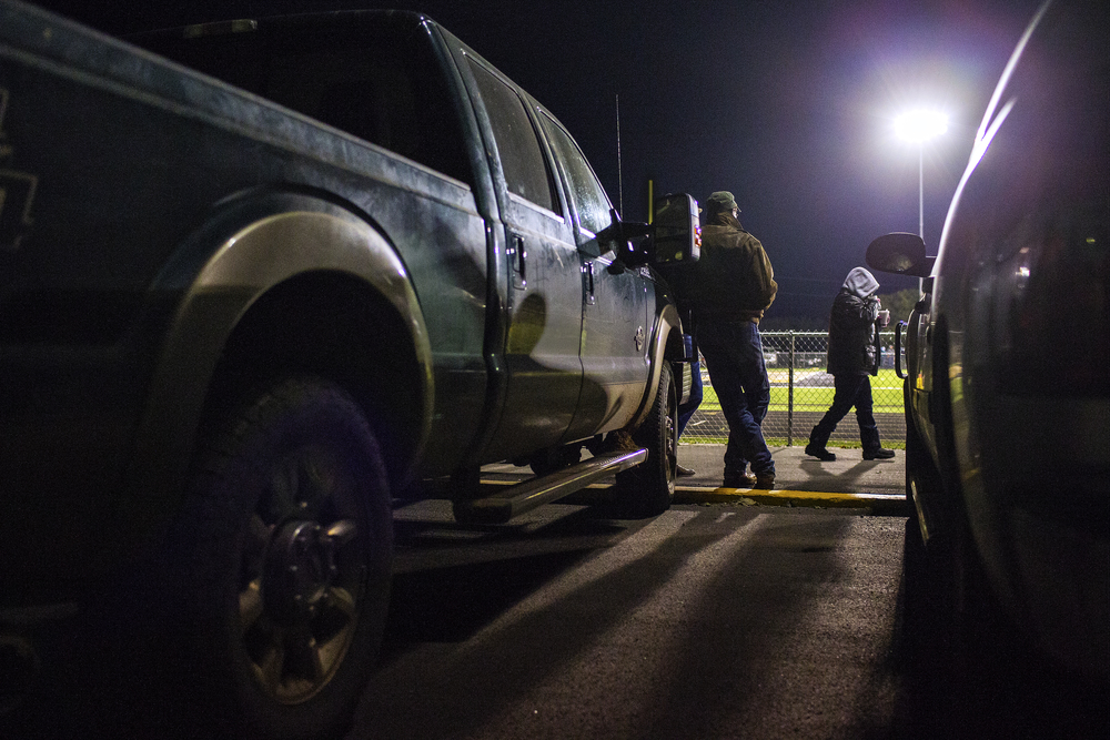 Roy W. Chisum leans on his truck as he watches the Jayton Jaybirds bi-district playoff game against Guthrie on Nov. 14, 2014 at Jaybird Stadium in Jayton, Texas. While some schools, like Jayton, have been playing six-man football since their establishment, there are many others which have grown out of the game thanks to increasing enrollment in their areas. Katy and Pearland High Schools, perennial high-classification powerhouses outside of Houston, got their start in six-man football in the 40's and 50's, as have done others like Friendswood, Dripping Spring, Cooperas Cove and more.