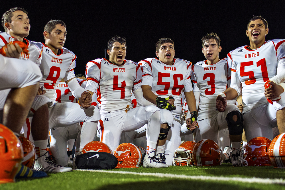 Laredo United quarterback Ignazio Tellez (9), wide receiver Erik Corona (4), defensive tackle Eddie Dominguez (56), safety Gus Trevino (3) and lineman Armando Valencia (51) celebrate in the Longhorns huddle after defeating the Weslaco Panthers in the area round of the Texas high school football playoffs on Nov. 22, 2014 at Alamo Stadium in San Antonio, Texas.