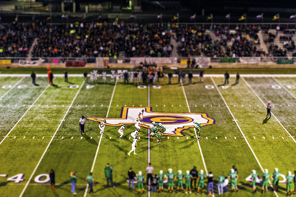 The May Tigers and Blum Bobcats line up against each other during their UIL playoffs semifinal round played at Pirate Stadium in Granbury, Texas on Dec. 6, 2014. May won the contest 60-38, advancing to the class-1A state championship game. UIL's 1A classification is reserved for the smallest public high schools in Texas and features six-man football instead of the traditional 11-man version of the game. This scaled-down version of the game is played with slightly different rules than its full-size counterpart, including a shorter and narrower field of play, no restrictions on who can receive a forward pass, slight scoring differences, among others. (NOTE: Image was processed using digital enhancement effects)