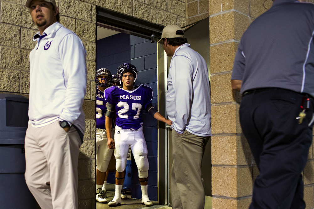 Mason running back Miguel Castillo stands at the edge of the Punchers' dressing room as he and his teammates wait to take the field for their 2A state semifinal against Centerville on Dec. 12, 2014 at B. E. Birkelbach Field in Georgetown, Texas. Miguel, a senior, was named to the 2A Associated Press all-state team as an honorable mention at linebacker as well as an honorable mention to the all-state academic team.