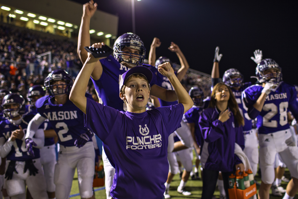 Matthew Kerr, 12, one of the Mason Punchers ballboys, cheers after a Mason score during first quarter action of their state semifinal game against Centerville on Dec. 12, 2014 at B. E. Birkelbach Field in Georgetown, Texas.