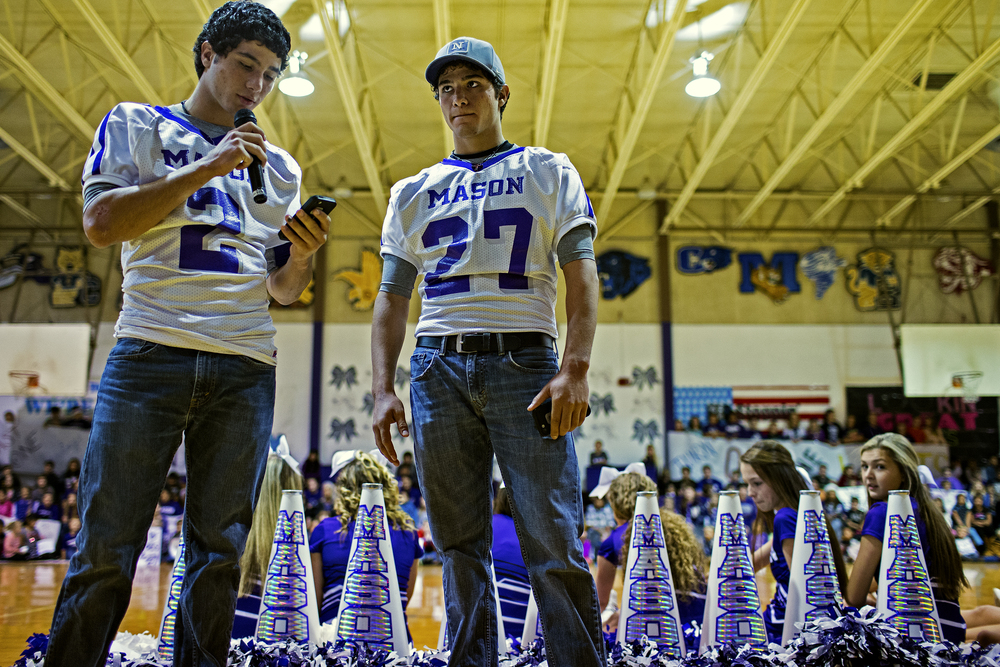 Miguel (left) and Luis Castillo speak at the Mason Punchers' last pep rally of the football season on Dec. 17, 2014 at Mason High School in Mason, Texas. It was also the last pep rally of the Castillo's lives, as they will graduate from high school this year and hope to attend the Naval Academy in 2015.