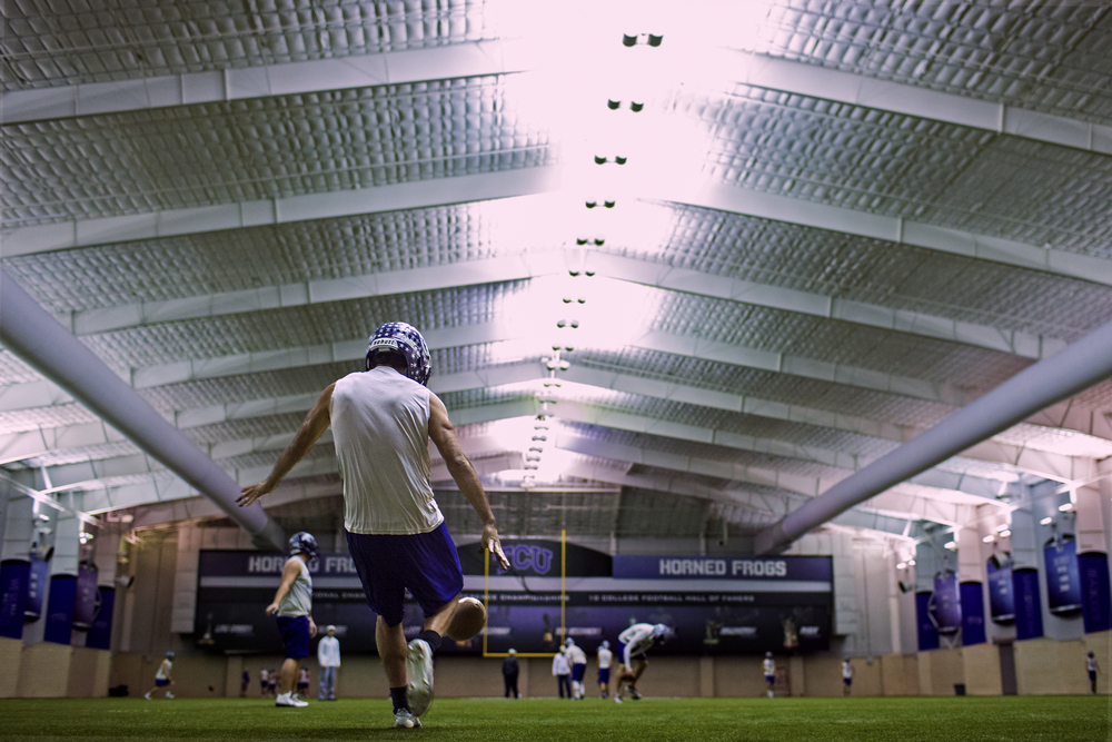 Luis Castillo practices punting at Sam Baugh Indoor Practice Facility in the Texas Christian University campus in Fort Worth, Texas on Dec. 17, 2014.