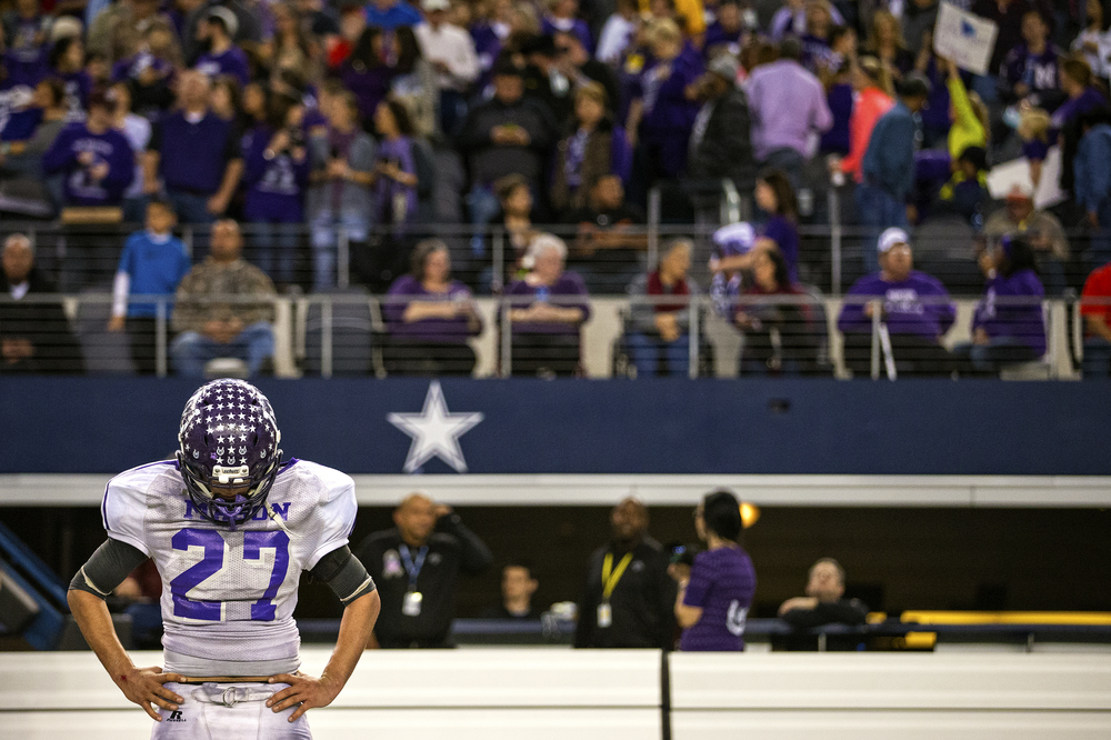 Luis Castillo stands in dejection seconds after the last game of his career ended with a 34-7 defeat at the hands of Canadian High School on Dec. 18, 2014 in Arlington, Texas. The Punchers were outplayed from the start of the game, only managing to score one touchdown in the first series of the game.