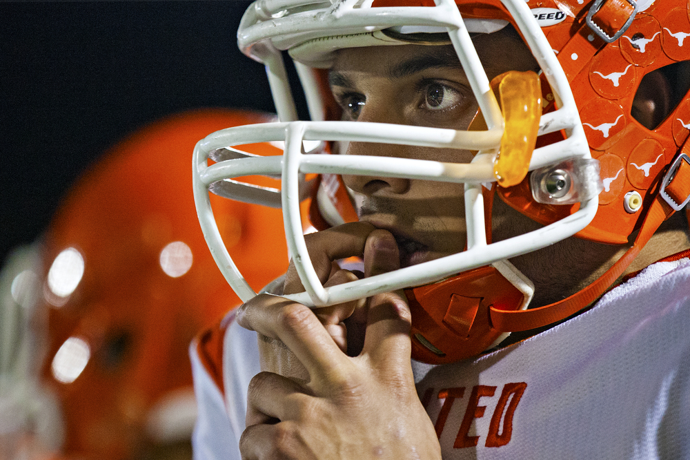 Laredo United senior wide receiver Erik Corona (4) watches nervously as the Longhorns defense attempts to stop Weslaco's drive short of the end zone during their area playoff game on Nov. 22, 2014 at Alamo Stadium in San Antonio, Texas.