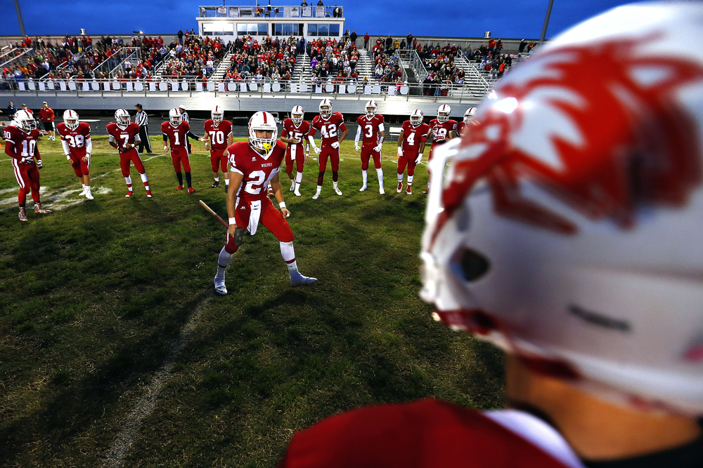 Reeds Spring High School tight end Tyler Morgan (24) pumps up his teammates prior the Wolves' game against Central High School at Carl Langley Field in Reeds Spring, Mo. on Oct. 9, 2015. Reeds Spring won the game 35-24.