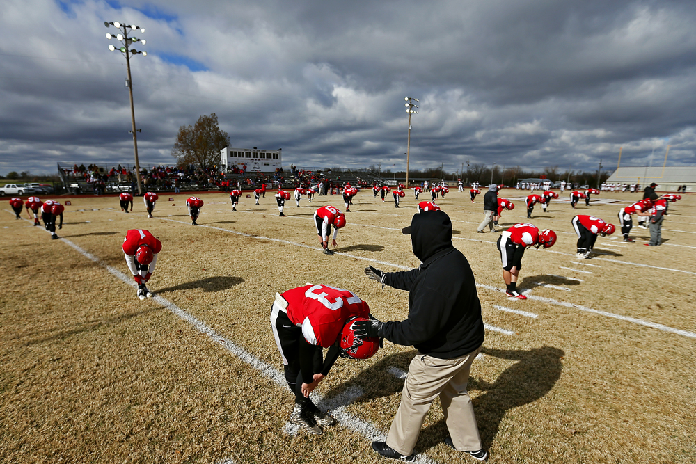 Aurora High SChool lineman Grayson Heath (53) and his teammates warm up prior to the start of the Houn' Dawgs Class 3 State Semifinal game against Odessa High School at Kelley Field in Aurora, mo. on Nov. 21, 2015. The Odessa Bulldogs won the game 14-7.
