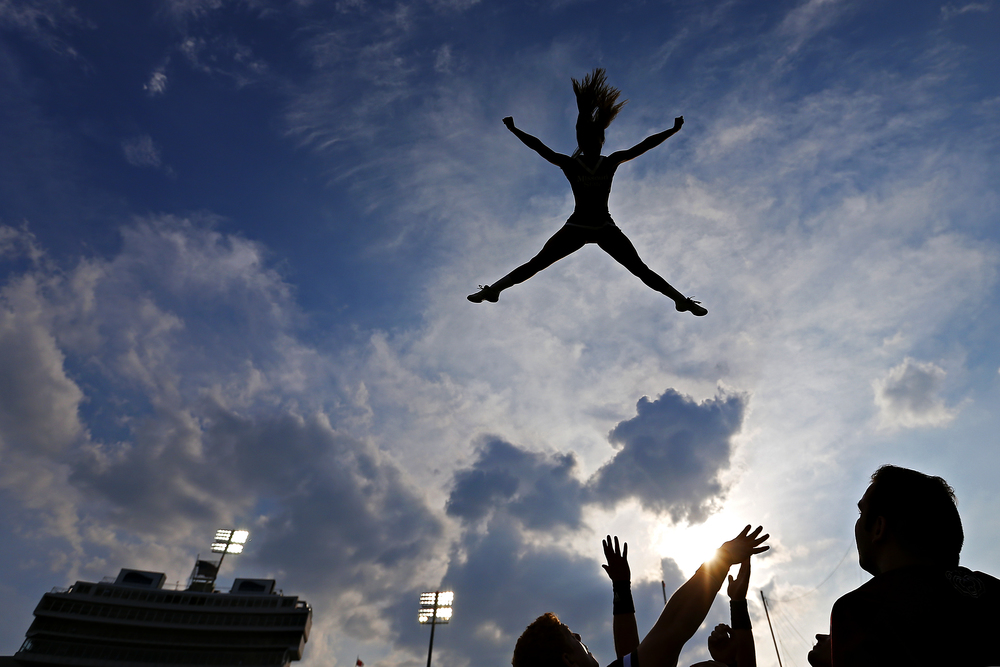 Missouri State University cheerleader Lacey Bertram flies up in the air during a stunt prior to the start of the Bears' season opener game against the Memphis Tigers at the Liberty Bowl Memorial Stadium in Memphis, Tenn. on Sep. 5, 2015. The Tigers won the game 63-7.
