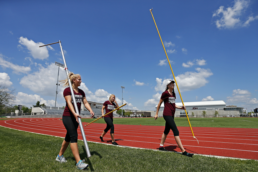 (from left) Missouri State Bears pole vaulters Nikki Buck, Julie James and Georgia Richardson carry pieces of equipment into the track prior to the start of the Missouri State Invitational track meet held at Betty and Bobby Allison South Stadium in Springfield, Mo. on April 22, 2016.