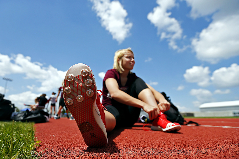Missouri State Bears pole vaulter Julie James puts on her cleats prior to the start of the Missouri State Invitational track meet held at Betty and Bobby Allison South Stadium in Springfield, Mo. on April 22, 2016. James finished in fifth place for the event.