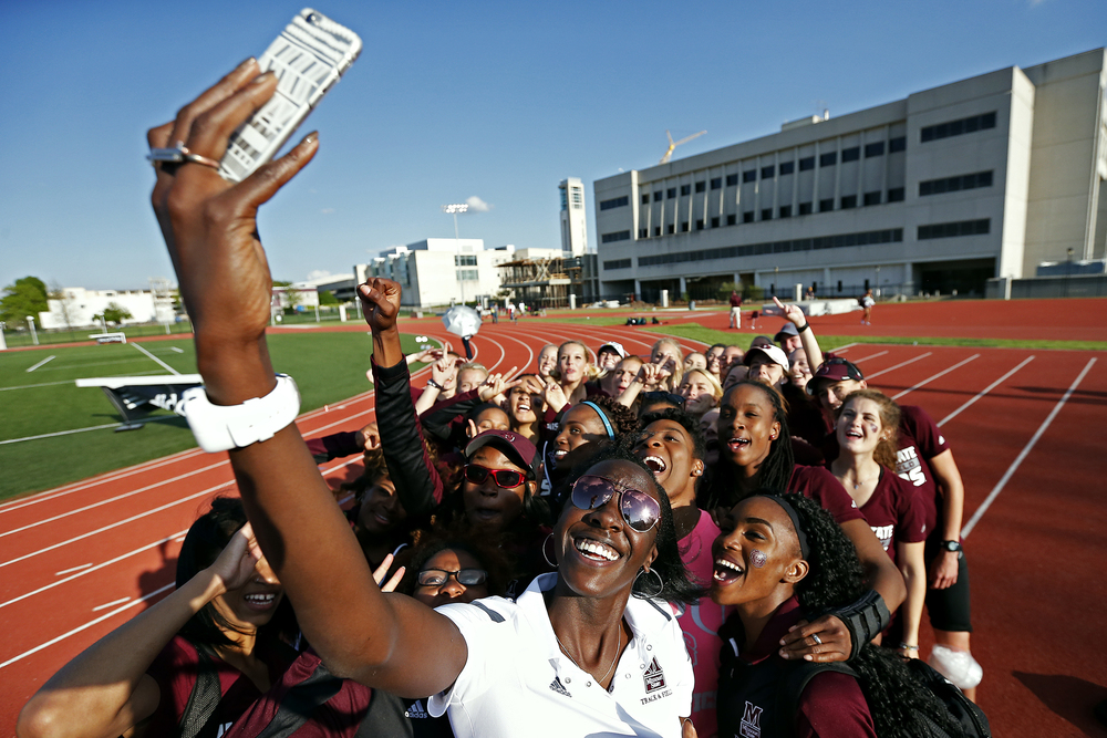 Former Missouri State track star Kara-Aretha Graham (front) takes a selfie with the Bears track & field team after the end of the Missouri State Invitational track meet held at Betty and Bobby Allison South Stadium in Springfield, Mo. on April 22, 2016.