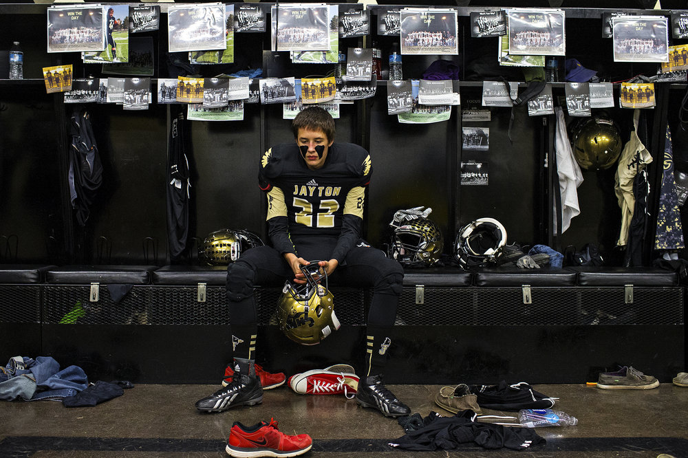 Jayton Jaybirds Freshman Judd Latham sits in the Jaybirds locker room before the start of their bi-district playoff game against the Guthrie Jaguars on Nov. 14, 2014. The Jaguars lived up to their billing as state champion contenders and beat the Jaybirds 84-34.