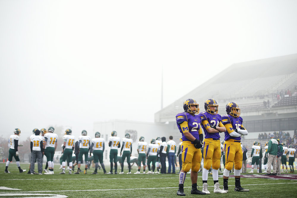 Monett High School running backs Patrick Valentine (21), D'Andre Johnson (24) and Brandon Majors (15) wait for their turn to run a drill during warm ups prior to the start of the MSHSAA Class 3 State Championship Game between the Monett High School Cubs and the Maryville High School Spoofhounds at Robert W. Plaster Stadium in Springfield, Mo. on Nov. 26, 2016. The Monett Cubs won the game 27-18.