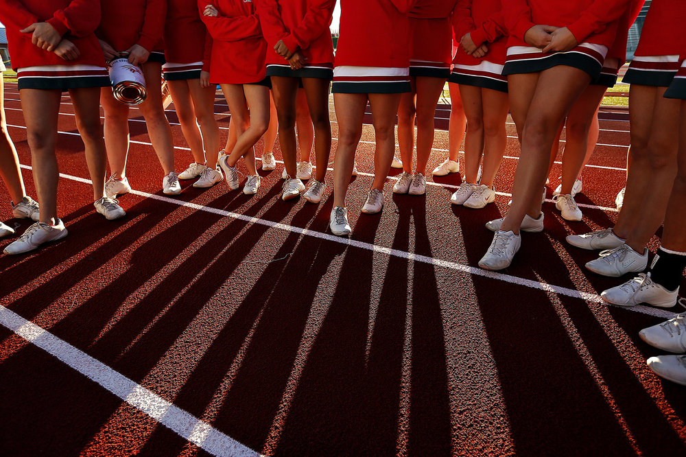 Nixa High School cheerleaders huddle prior to the start of the game between Nixa High School and Ozark High School held at Tiger Stadium in Ozark, Mo. on Oct. 7, 2016. The Ozark Tigers won the game 28-27.