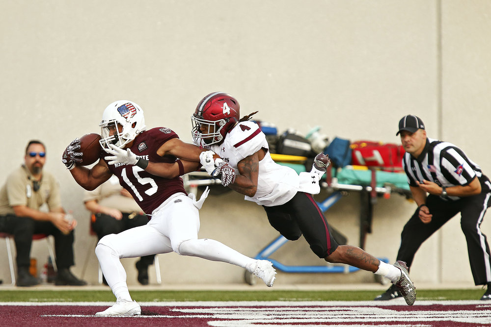 Missouri State Bears wide receiver Zac Hoover (15) makes a one-handed touchdown reception as Southern Illinois Salukis cornerback Roman Tatum (4) attempts to cover him during fourth quarter action of the Missouri Valley Conference game between the Missouri State Bears and the Southern Illinois Salukis at Robert W. Plaster Stadium in Springfield, Mo. on Oct. 29, 2016. The Bears won the game 38-35.