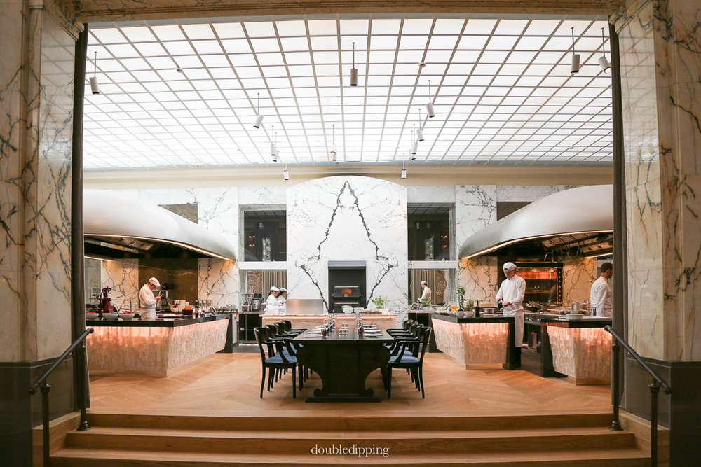 The former hall for the customers of the bank is now transformed into an amazing open-view kitchen and restaurant