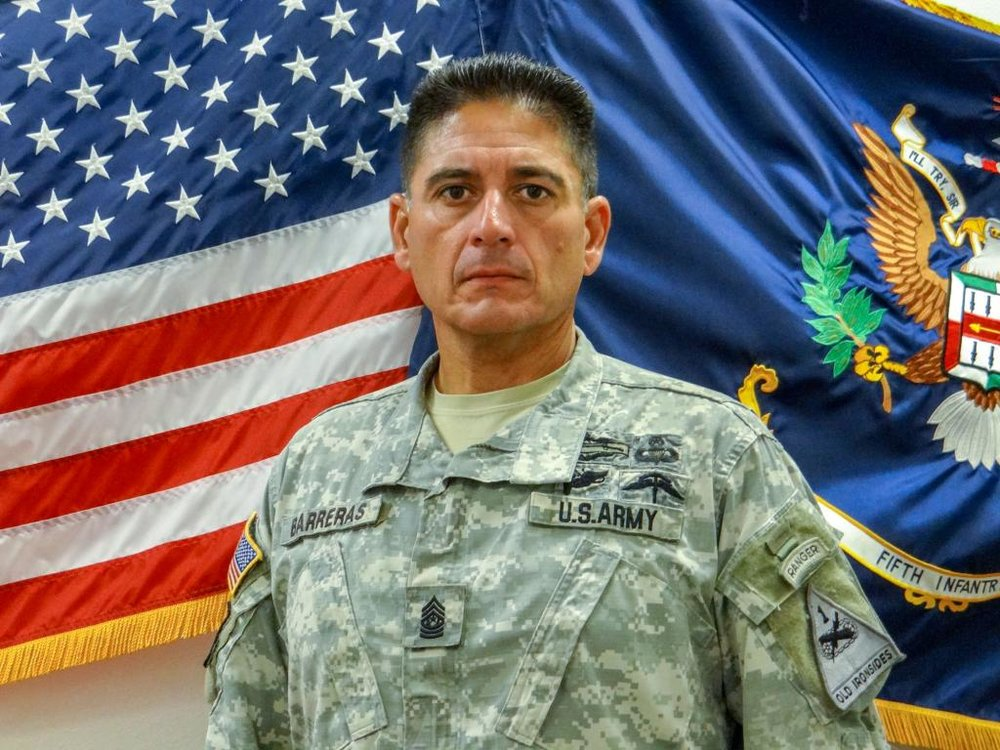 """Command Sgt. Maj. Martin """"Gunny"""" Barreras, 49, of Tucson, Arizona, died on May 13, 2014, of wounds he sustained while leading a successful rescue mission in Herat Province, Afghanistan. Barreras joined the Marine Corps in 1983 and the Army Rangers in 1988. He was the senior enlisted adviser in the 2nd Battalion, 5th Infantry, 3rd Brigade Combat Team, 1st Armored Division, Fort Bliss, Texas.  He used CrossFit training to improve his fitness and the fitness of his unit. Murph and Griff were among his favorite workouts.  He is survived by his wife, Melinda; daughters, Amice and Victorria; and son, Calvin."""