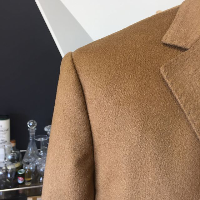 Shortening sleeves the correct way on this 100% cashmere overcoat. Need some alterations done? Drop into Edward McCann in Claremont.