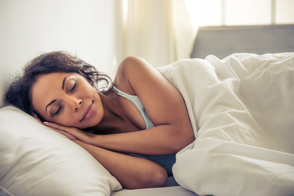 Woman sleeping soundly on bed