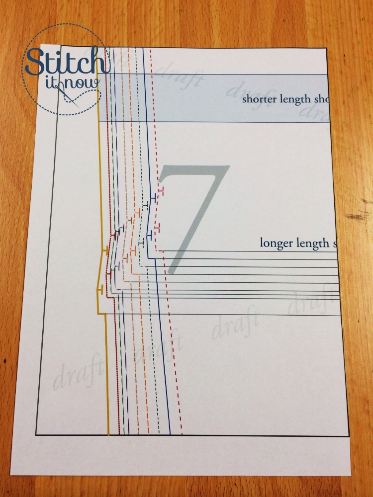 """This is the pattern piece showing the short hem markers. The first marker is 1.5cm (5/8"""") up from the hemline and the second marker is 2.5cm (1"""") above the second. This means you turn the short hem up 1.5cm (5/8"""") and then 2.5cm (1""""). Of course, you should always check the length on your child to allow for their leg length and preferred wearing length, before sewing the final hem in place."""