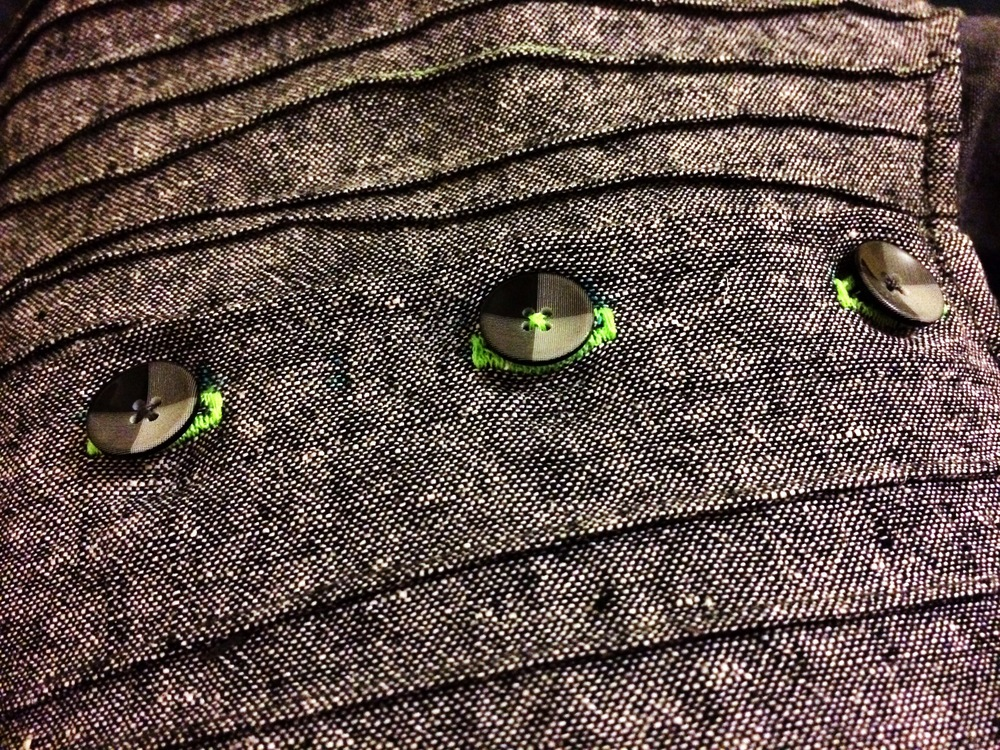I love everything in this photo - the buttons, the buttonhole colours, the one button sewn on in fluro green thread and those crooked bamboo improvised pleats!  In hindsight, after taking the photos, I think I should have ironed the pleats towards the middle of the shirt instead of in the same direction all the way across.  The right side stands out so much more than the left.