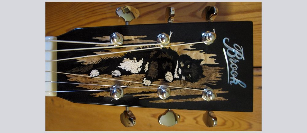 Cat headstock inlay