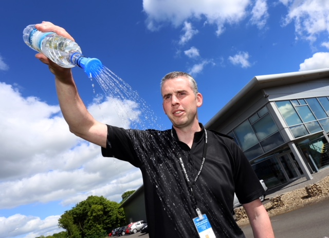 Sergeant Scott Howard, of West Midlands Police, demonstrates THE BOTTLESHOWER