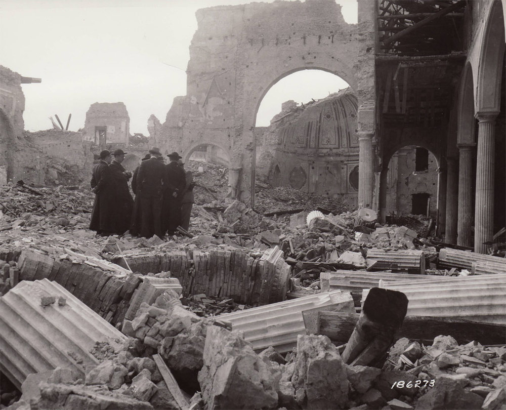 Priests among the ruins of the cathedral in Benevento October 24 1943. Image courtesy Holtzbrinck.