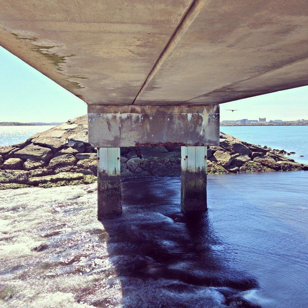 Under The Bridge  #bridge #water #ocean #perspective #landscape #boston #rocks #pleasurebay #hdr #iphone #duality #casefoto