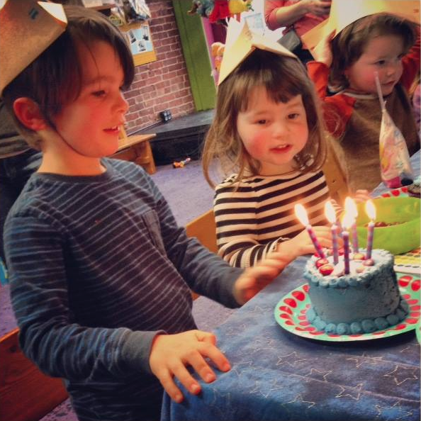 child's birthday celebration with cake in lobby