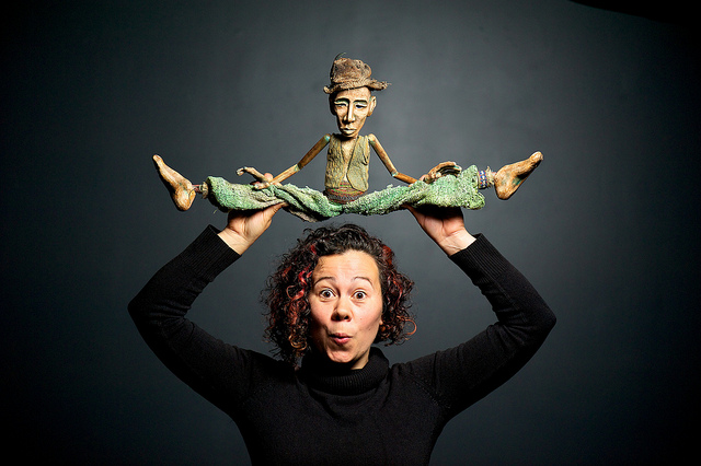 Faye Dupras posing with one of her puppets.