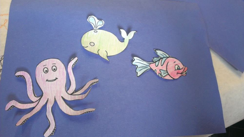 Ask an adult for help cutting out the sea animals if necessary.