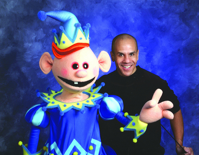 Jonathan McDonough poses with one of his puppets!