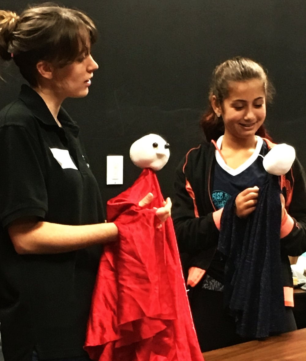 It's been a busy first month! Here I am teaching table top puppetry to middle schoolers in September.