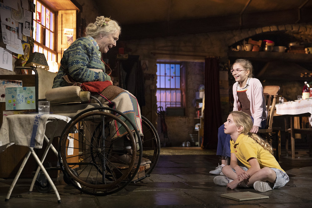 "When ""Aunt Maggie Far Away"" (Fionnula Flanagan) comes back, her nieces pull up a chair. On floor, Matilda Lawler as Honor Carney (7). In chair, Brooklyn Shuck as Nunu Carney ( 11) . Photo by Joan Marcus."