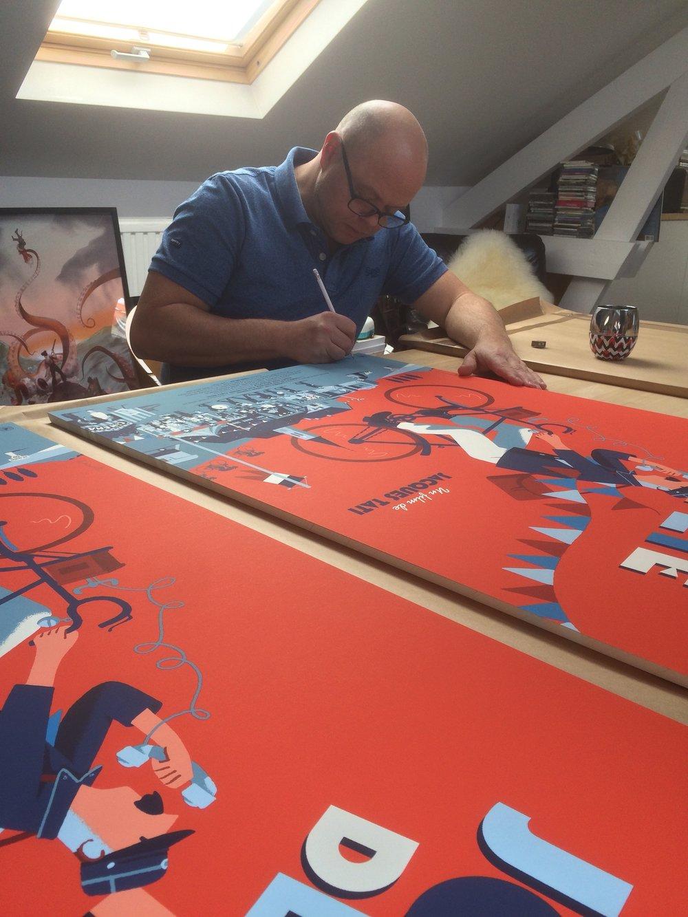 """David Merveille signing his last print """"Jour de Fête"""""""