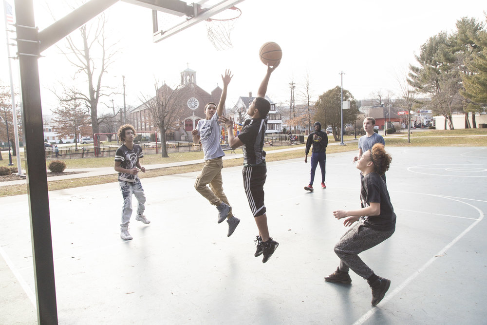 Young men in Bristol take advantage of a 55-degree day in January.