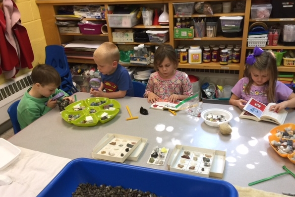 Students in our pre-K class examine rocks and minerals to determine differences and things that make them unique.