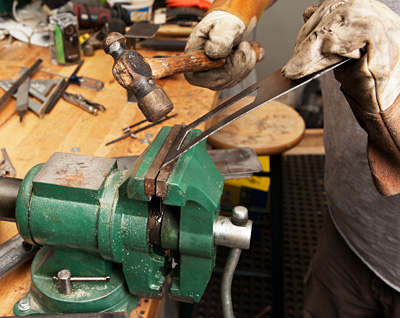 Next is bending the blanks into the final form. A large vise and hammer took care of this task without much effort.