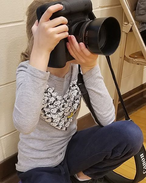 My tiny second shooter at this weekend's basketball games. I have 635 photos to start sifting through now, with some really creative ones thanks to her.