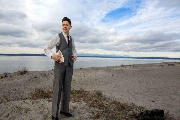 this and the other photo of me in a suit by the sea shore with a sea shell by Tim Summers