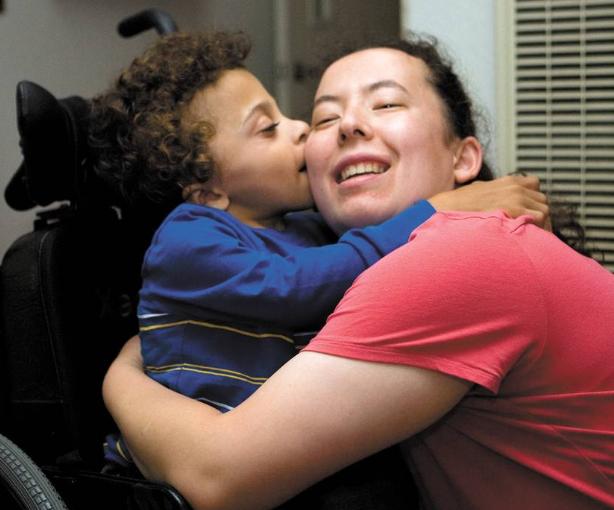 Susie de Groot hugs Xander, who lives at the de Groot Nursing Home for Children, operated by     Susie's mother    —Sjany de Groot.