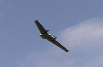 One of our RF 70s airborne over a corn field.