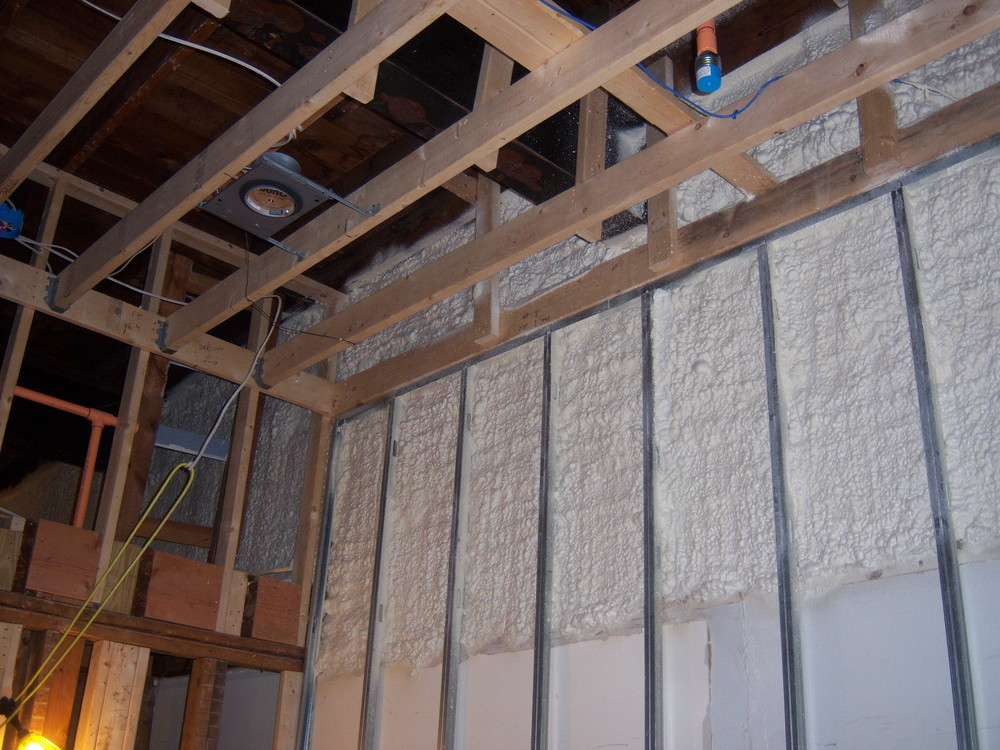 Spray foam insulation between metal studs