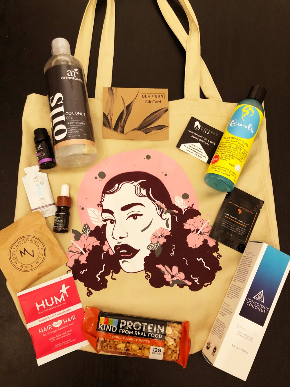 The gift bag was BOMB, thank you so much:  KIND PROTEIN BAR ,  HUM ,  CURLS ,  CONSCIOUS COCONUT ,  FOREVER WILD ORGANICS ,  KREYOL ESSENCE ,  ART NATURALS ,  COOLA ,  NATURALS OF ALKEBULAN ,  BLK _ GRN GIFT CARD ,  MOVITA