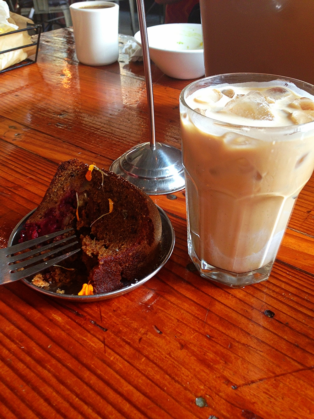 Iced latte and a delightful confection with blackberries, orange and quinoa.