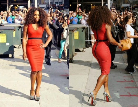 Serena looking very striking in red knee length-zip back dress and studded Christian Louboutins  in NYC